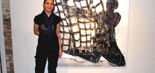 Антония Гюрковска със своя картина по време на първата й самостоятелна изложба в САЩ /2010 г./